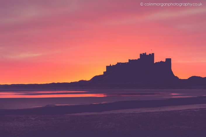 Colin Morgan Photography © Bamburgh Castle Sunrise Silhouette. Ref 7676 Landscape/Seascape Photograph | Print | Canvas